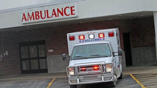 Paramedics with Reading Emergency Unit offload a patient at Hillsdale Hospital's emergeny room.