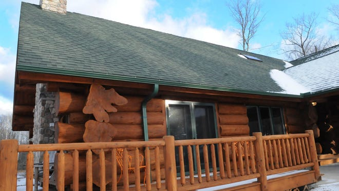 Front wing of the 5,200-square-foot Andersen log home with massive ornate handcrafted corner pieces in Fish Creek.