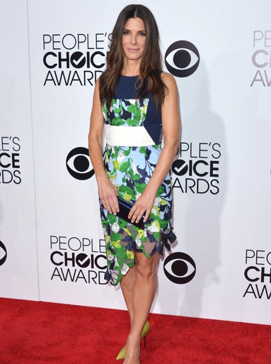 Favorite movie actress winner Sandra Bullock anchored her fluttery, foliage-adorned a Peter Pilotto frock with kicky yellow Kurt Geiger pumps and a Jimmy Choo clutch.