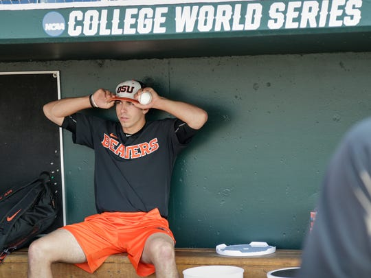 Oregon State pitcher Luke Heimlich sits in the dugout before practice at TD Ameritrade Park in Omaha, Nebraska on Friday. Oregon State plays North Carolina on Saturday in the NCAA College World Series.