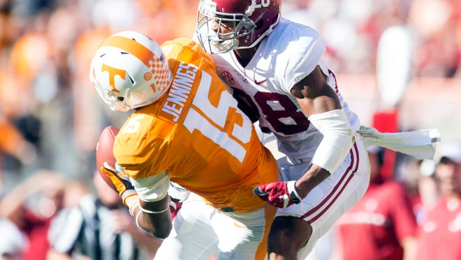 Alabama defensive back Anthony Averett, right, breaks up a pass intended for Tennessee wide receiver Jauan Jennings on Saturday at Neyland Stadium.