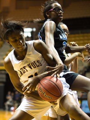 Jeff Davis' Keajia Williams (21) fights for a rebound with Auburn's Casey Core during the AHSAA Regional Tournament playoff game on Thursday, Feb. 16, 2017, in Montgomery, Ala.