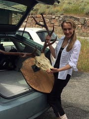 Anita Thompson pulls trophy antlers out of her car trunk while returning them to the former home of writer Ernest Hemingway. Aug. 5, 2016