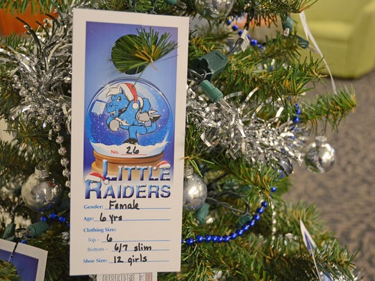 """This Little Raiders ornament is among those hanging on three trees across campus supporting the Little Raiders gift-giving campaign. Secret Santas can pick an ornament to """"adopt"""" a local child's Christmas wish list."""