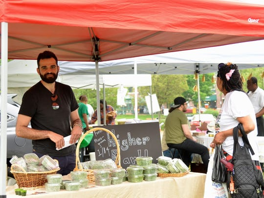 Opening day of the Englewood Farmers' Market. Higher