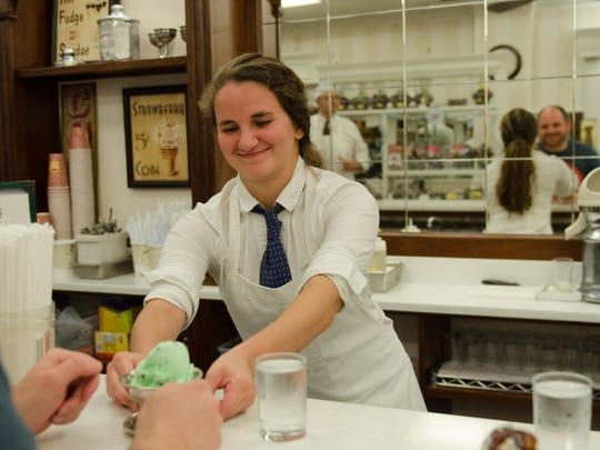 Celia Cattabiani of Conrad's Confectionery serves ice