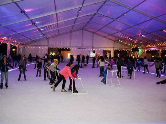 Skaters play on the ice in a seasonal outdoor rink in Modesto, California. The same owners are bringing a temporary rink to Salem Nov. 17 in Riverfront Park.