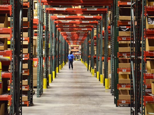 An employee checks packages inside the Radial fulfillment center in Reno.