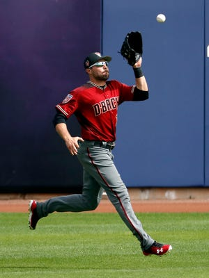 Arizona Diamondbacks' A.J. Pollock catches a fly out against the Milwaukee Brewers during the second inning of a spring training baseball game Thursday, March 8, 2018, in Phoenix. (AP Photo/Matt York)