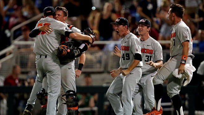 Jun 27, 2018; Omaha, NE, USA; Oregon State Beavers pitcher Jake Mulholland (38) celebrates with his team after beating the Arkansas Razorbacks in game two of the championship series of the College World Series at TD Ameritrade Park. Mandatory Credit: Bruce Thorson-USA TODAY Sports