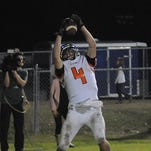 Catholic wide receiver Parker Sulik scored three touchdowns, including a catch in the final 25 seconds of regulation and one in overtime.