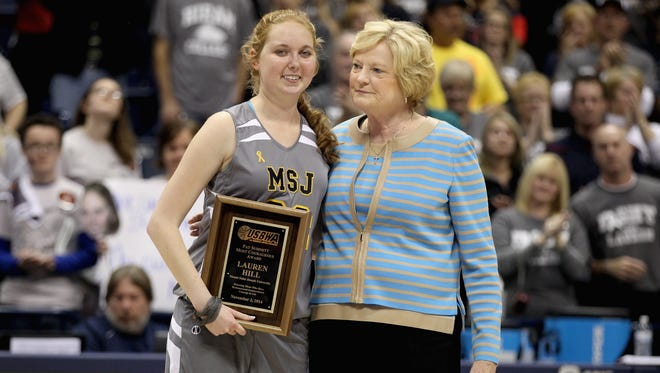 CINCINNATI, OH - NOVEMBER 02:  Lauren Hill of Mount St. Joseph shares a hug with Pat Summitt during a halftime awards ceremony during the game against Hiram at Cintas Center on November 2, 2014 in Cincinnati, Ohio. Hill, a freshman, has terminal cancer and this game was granted a special waiver by the NCAA to start the season early so she could play in a game.  (Photo by Andy Lyons/Getty Images)
