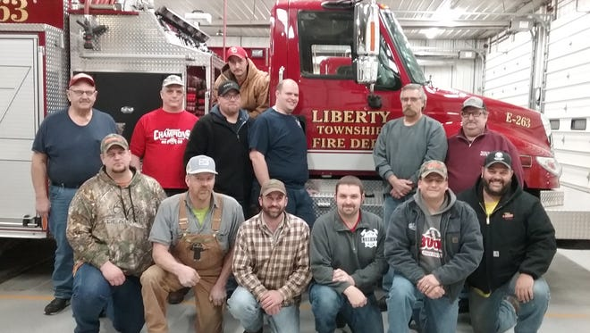 From left, front, are Erick Foght, Ben Lucius, Allen Sanders, Neil Metzger, Chad Wagner, Phil Feik; back, are Ed Foght, Bob Geiger, Luke Cramer, Chris Eicher, Rick Harley, Todd Kenned; and on the truck is Doug Cramer.