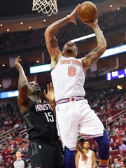 New York Knicks forward Michael Beasley (8) drives to the basket past Houston Rockets center Clint Capela (15) during the first half of an NBA basketball game, Saturday, Nov. 25, 2017, in Houston. (AP Photo/Eric Christian Smith)