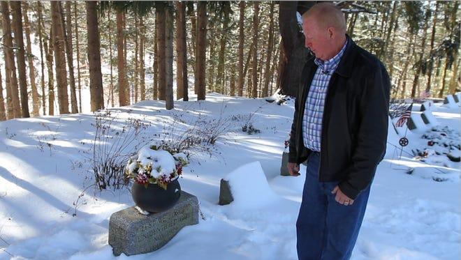 Former Livingston County Sheriff John York at the grave for Tammy Jo Alexander.