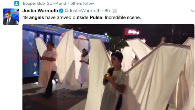 Forty nine 'angels' appeared outside of the Pulse nightclub early Monday.