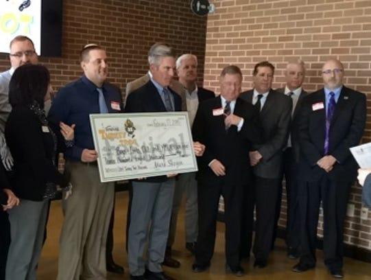 Representatives of 14 Wisconsin nonprofits display