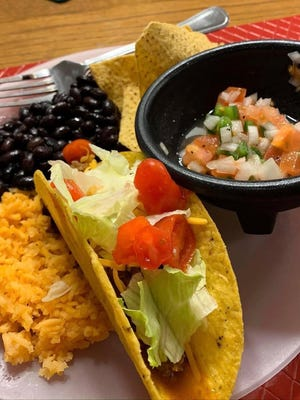 Taco dinner complete with pico de gallo, black beans and Mexican rice.
