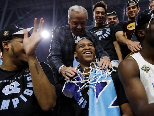North Carolina head coach Roy Williams, left, celebrates with forward Isaiah Hicks, right, after the championship game against Gonzaga at the Final Four NCAA college basketball tournament, Monday, April 3, 2017, in Glendale, Ariz. North Carolina 71-65. (AP Photo/David J. Phillip)