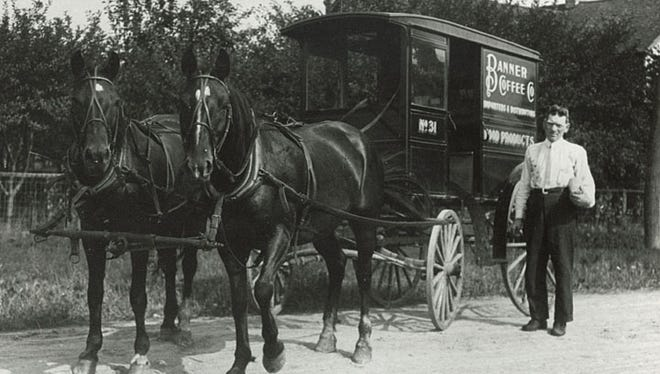 The Banner Coffee Company delivery wagon is shown in this 1912 photograph. The man is unidentified.