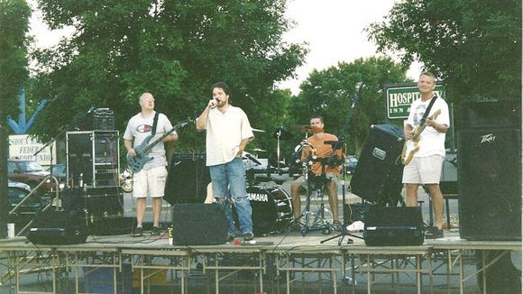 Me, singing a John Mellencamp song outside Buffalo Wild Wings, circa 2002