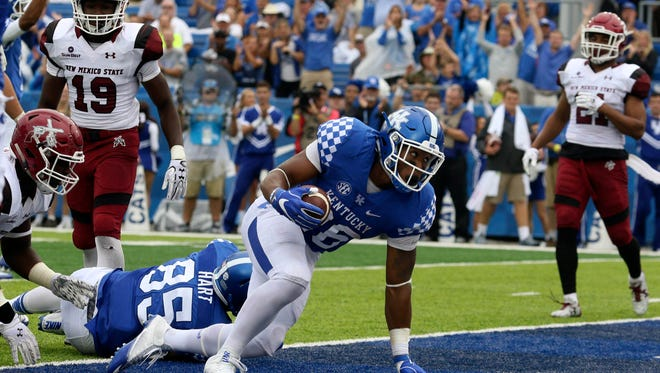 Sep 17, 2016; Lexington, KY, USA; Kentucky Wildcats running back Benny Snell Jr (26) runs the ball for a touchdown against the New Mexico State Aggies in the first half  at Commonwealth Stadium.