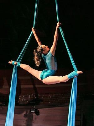 Sarah Sporich performing her aerial silks with Cirque de la Symphonie.