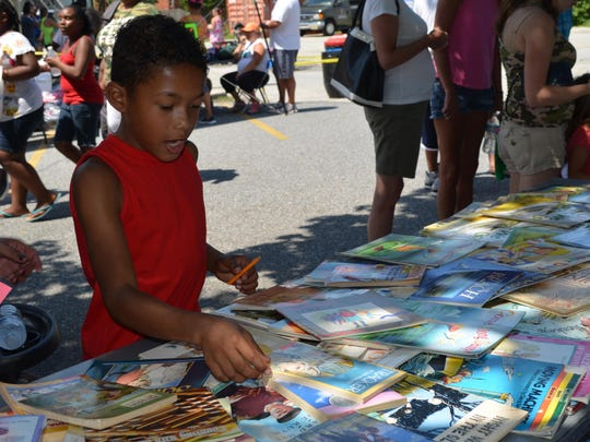 Darian Handy, 9, of Millville picks out a free book