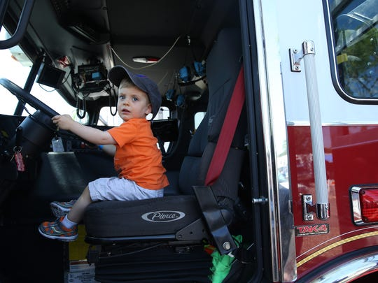 2-year-old Hunter VanDerveen of Parsippany checks out a Parsippany fire truck during the Kiwanis Club of Greater Parsippany, hosting its annual Touch-A-Truck event, a fundraising endeavor to benefit the Kiwanis. June 18, 2016, Parsippany, NJ