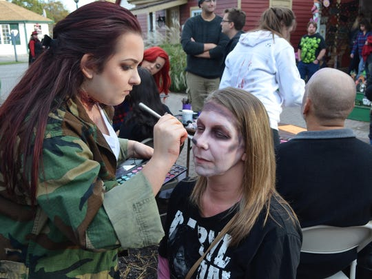 Professional make-up artists like Alexa Quaranta-Kelly of Mays Landing were on hand to provide zombie makeovers for visitors like Amy Burns of Blackwood.