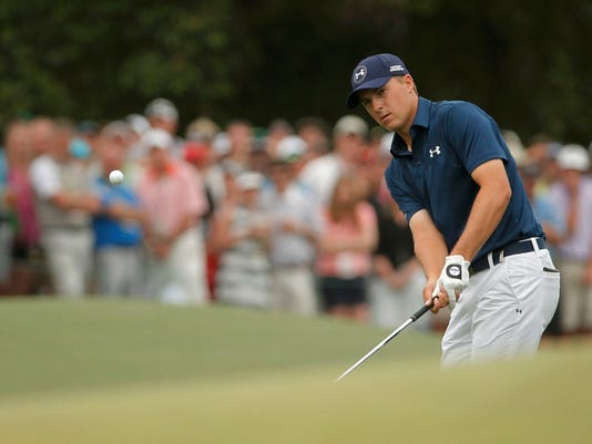 Jordan Spieth of the U.S. chips onto the eighth green during the final round of the Masters golf tournament at the Augusta National Golf Course in Augusta