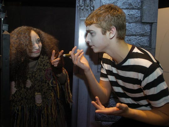 Perry Kreiss as Pugsley Addams runs through a scene with Chayse Hurley as Grandma.
