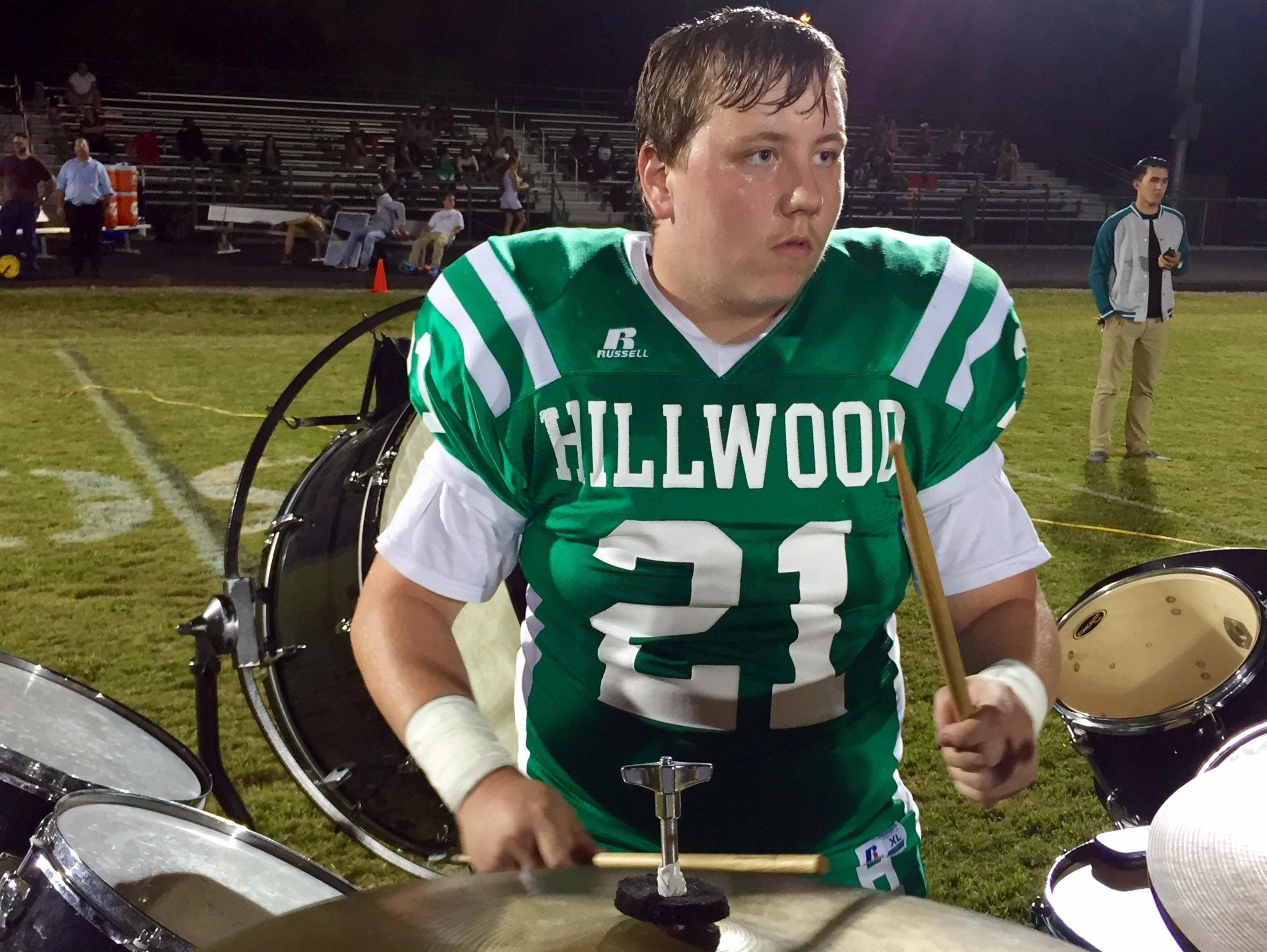 Haskell Sexton, a junior on the Hillwood football team, also plays a full set of drums during halftime with the Hilltopper marching band.