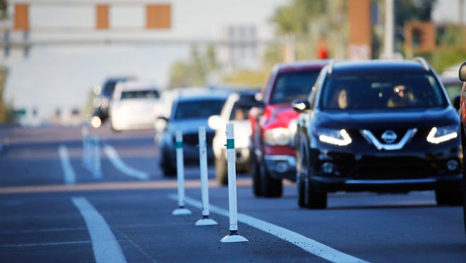 White posts act as safety barriers for bike lanes on the southbound side of McClintock Drive near the U.S. 60 in Tempe, Ariz. Tempe added bike lanes and reduced traffic lanes in July 2015. Hundreds of residents have complained about the lanes. They say traffic congestion has increased in the area.