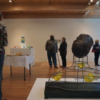 Guests mingle during the opening of Glass Matrix, The Cleveland Connection show at the Mansfield Art Center.