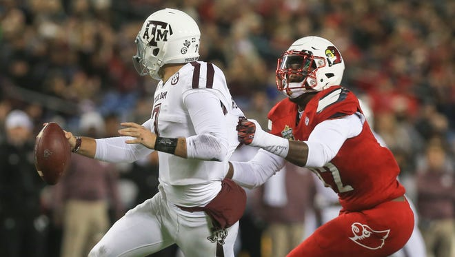 Louisville's Devonte Fields sacks Texas A&M's Jake Hubenak for a loss in the first half.