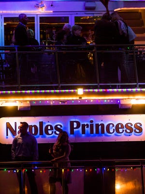 """The Naples Princess starts the Naples Boat Parade on Saturday, December 10, 2016, in the city of Naples. Boaters were encouraged to decorate their boats along with the """"super hero"""" theme for the 27th annual parade."""