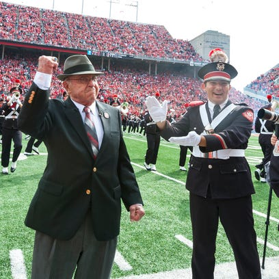 Former Ohio State football coach Earle Bruce dots this
