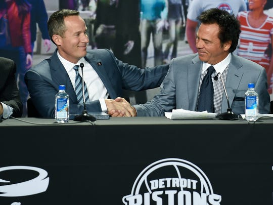Ilitch Holdings CEO Chris IIitch, left, and Pistons owner Tom Gores shake hands during the end of the news conference announcing the Pistons' move to Little Caesar's Arena in downtown Detroit,  Nov. 22, 2016.