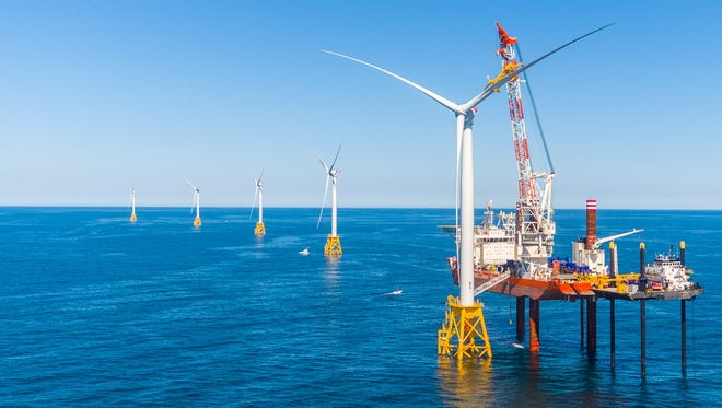 Crews install one of five turbines of the Deepwater Wind project off the Rhode Island coast.