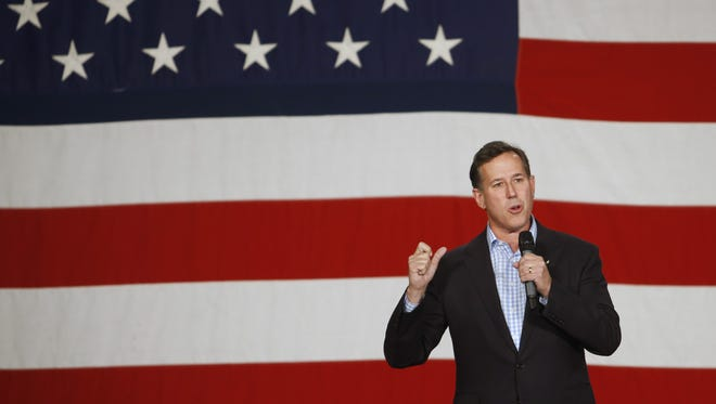 Republican presidential candidate Rick Santorum speaks Saturday, Oct. 31, 2015, during the Growth and Opportunity Party at the Iowa State Fairgrounds in Des Moines.