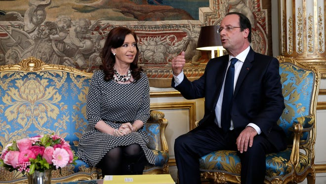 Argentine President Cristina Fernandez de Kirchner meets with French President Francois Hollande at the Elysee Palace in Paris last month.