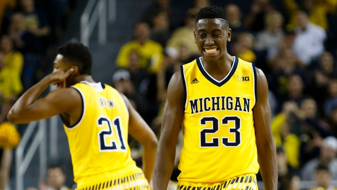 Nov 20, 2015; Michigan Wolverines guard Caris LeVert (23) reacts to a three point basket by guard Zak Irvin (21) in the first half against the Xavier Musketeers at Crisler Center.