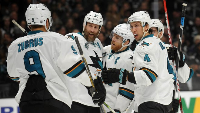San Jose Sharks center Joe Thornton (19) celebrates with right wing Dainius Zubrus (9), center Joe Pavelski (8) and defenseman Brenden Dillon (4) his goal scored against Los Angeles Kings during the first period at Staples Center.