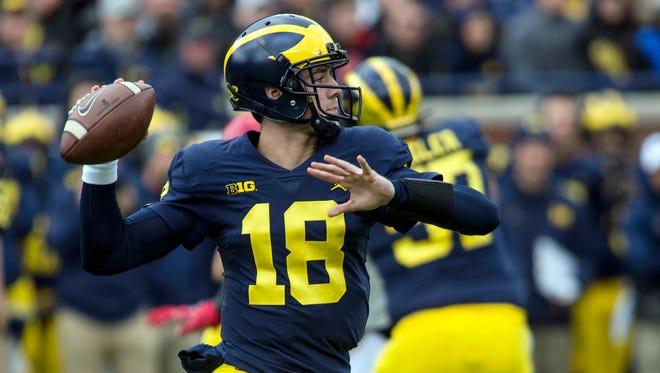 Michigan quarterback Brandon Peters throws a pass in the second quarter against Rutgers in Ann Arbor, Saturday, Oct. 28, 2017.