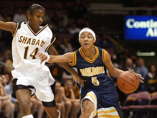 Sharnee Zoll of Marlboro dribbles past Jania Sims of Shabazz in the first quarter of the 2003  Tournament of Champions final at the Meadowlands.