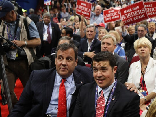 New Jersey Governor Chris Christie sits with his son