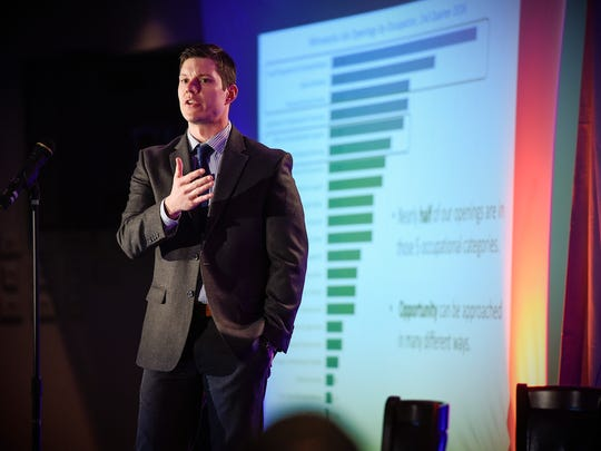Luke Greiner, regional analyst for central and southwestern Minnesota, Department of Employment and Economic Development, presents his information during the Winter Institute economic summit Thursday, Feb. 23, at the Regency Plaza.
