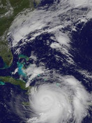 "Hurricanes can be 60,000 feet ""thick,"" extending to"
