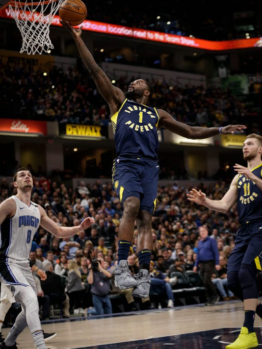 Indiana Pacers guard Lance Stephenson (1) scores in front of Orlando Magic guard Mario Hezonja (8) during the second half of an NBA basketball game in Indianapolis, Saturday, Jan. 27, 2018. (AP Photo/AJ Mast)